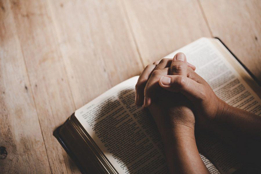 spirituality-religion-hands-folded-prayer-holy-bible-church-concept-faith